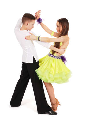 Boy and girl dancing ballroom dance on white background Фото со стока
