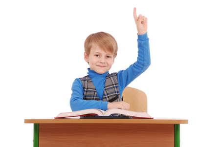 6 7 years: Boy raising hand to ask question isolated on white