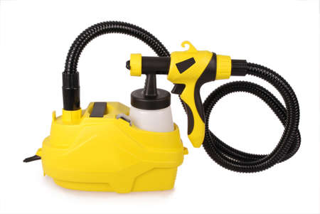 compressed air: Yellow paint sprayer isolated on white background Stock Photo