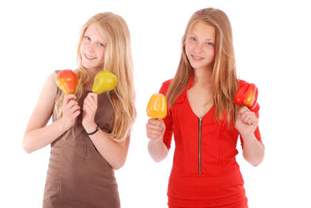 two persons only: Young girl holds near the face apples and pears isolated on white