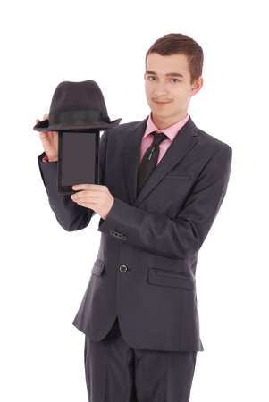 only one teenage boy: Boy in a black suit holds a tablet PC, fun isolated on white