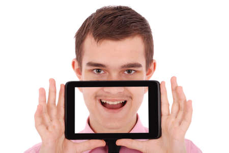 only one teenage boy: Boy in a pink shirt hold a tablet PC in front of his face isolated on white. Fun Stock Photo