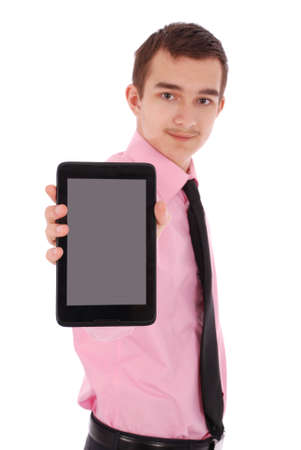 only one teenage boy: Boy in a pink shirt hold a tablet PC isolated on white. Shallow depth focus on tablet PC Stock Photo