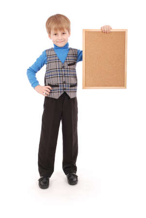 6 7 years: Boy holding a board made of cork isolated on white