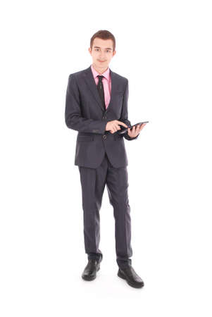 only one teenage boy: Boy in a black suit hold a tablet PC isolated on white Stock Photo