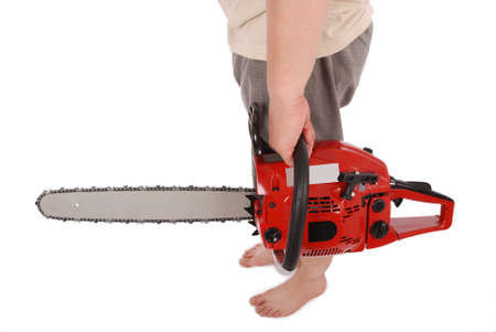one hand: By one hand holding a chainsaw isolated on white Stock Photo