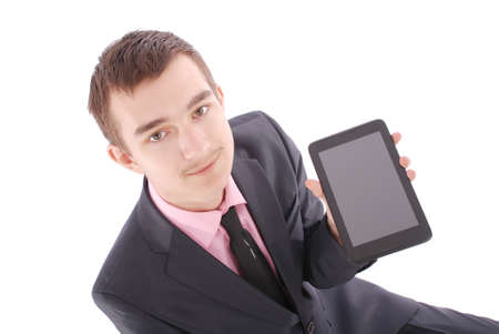 only one teenage boy: Boy in a suit sitting and holding a tablet PC isolated on white
