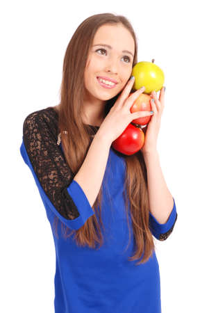 three persons only: Young smiling brunette girl holding three apples isolated on white