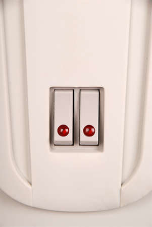 toggle switch: Toggle switch with red LED on the electric radiator Stock Photo