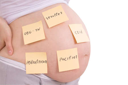 regnant: ?regnant belly and sticker notes, woman planning tasks isolated on white. Clipping path inside