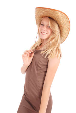 Pretty thirteen year old girls wearing a big floppy straw sun hat isolated on white