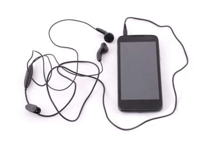 medium: Smartphone and headphones on white background with soft shadow Stock Photo