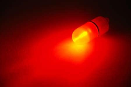 Fishing red LED power indicator isolated on black background