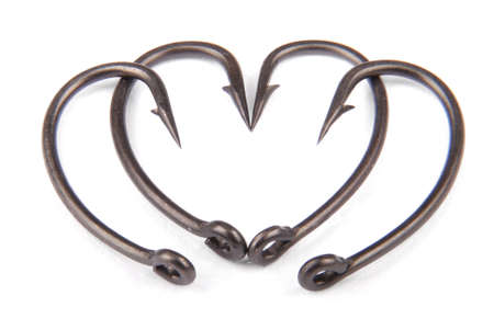 Four fishhook drawn up in heart shaped isolated on white backround. Clipping path