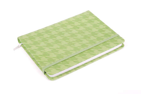 returned: Green notepad returned right angle to us isolated on white background with soft shadow (Clipping path)