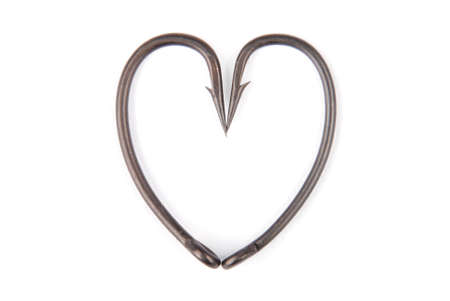 Two fishhook drawn up in heart shaped isolated on white backround. Clipping path