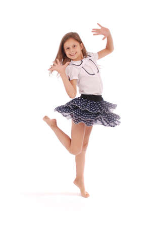 Happy young girl dancing isolated on white background