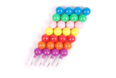 Set childrens toy pencils from color plastic balls isolated on white background