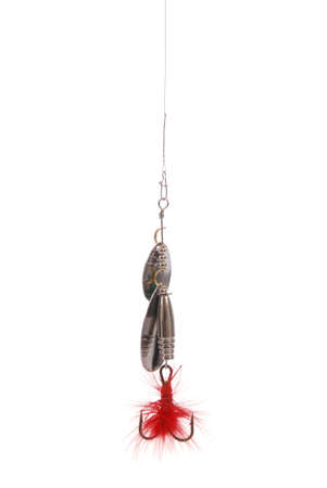 Metal fishing spoon hanging top of the screen isolated on white