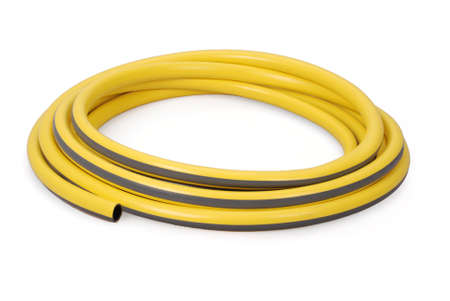 Yellow garden water hose rolled up in a tangle isolated on white Stock Photo
