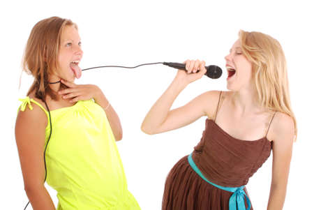 Young beautiful teenage girl conducts interviews with the singer. Isolated on white background Stock Photo