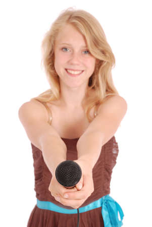 an entertainer: Teenage girl holding a microphone in front. Isolated on white background