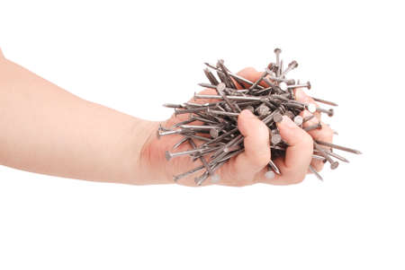 Mans hand holding metal nails. Closeup with clipping path isolated on white background