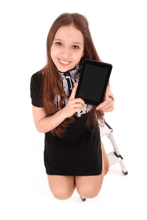 Happy student teenage girl sitting on the ladder with tablet pc isolated on white