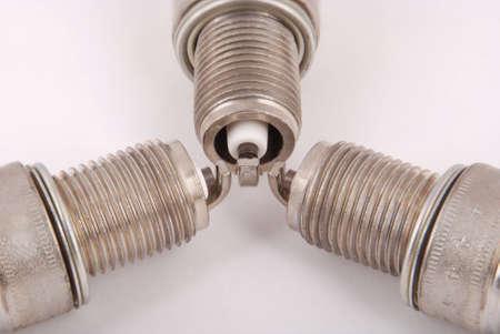 Three new spark plug on a gray background Stock Photo