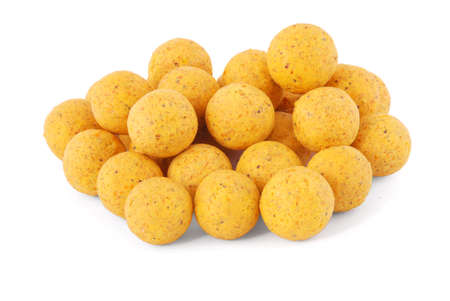fishing rig: Yellow boilies, carp fishing baits, isolated on white background with soft shadow