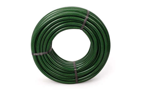 Green garden water hose rolled up in a tangle isolated on white background with soft shadow. Photo with clipping path