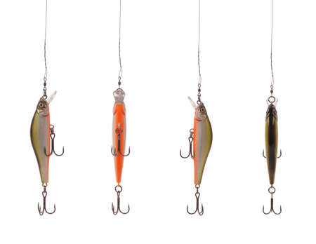 Four fishing floating wobbler hanging top of the screen isolated on white
