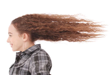 girl lying studio: Girl in the Wind. Portrait girl whose hair is flying in the wind isolated on white Stock Photo