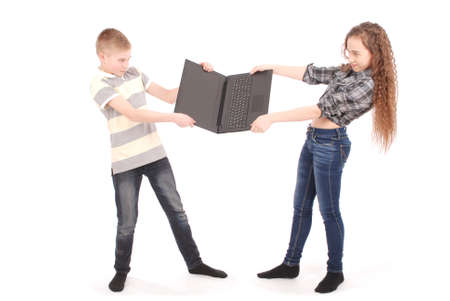 nuisance: Boy and girl fighting over a laptop, isolated on white Stock Photo