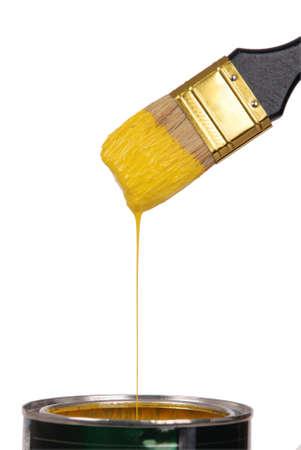 Yellow paint splashing out of brush. Isolated on white background