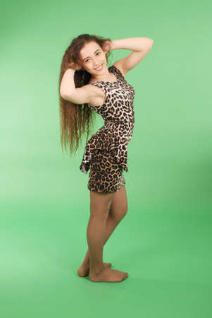 Beautiful girl with long wavy hair. Isolated on green Stock Photo