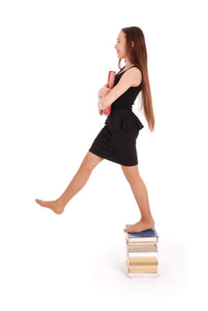 beginner: Education, people, teenager and school concept - teenager school girl standing on stack of books. Isolated over white