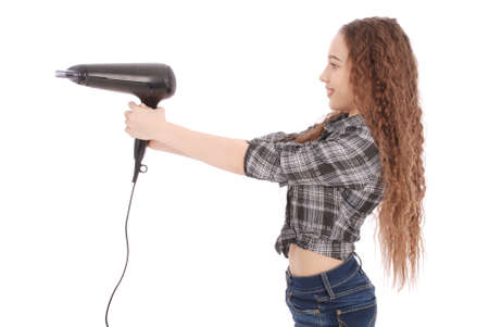 Young girl with hair dryer isolated on white Stock Photo