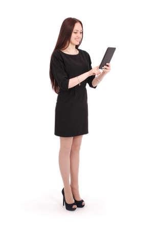 Happy student teenage girl keeps tablet pc standing sideways isolated on white Stock Photo