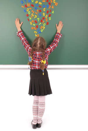 Girl stands in front of a green school board with magnets of figures that depict her thoughts on white background