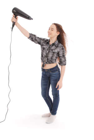 Young girl using hairdryer isolated on white background