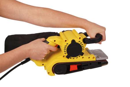 Hand holds new professional finishing sander isolated on white background Stock Photo