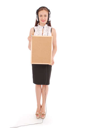 Teenage girl in headphones, holding cork board. Isolated on white background