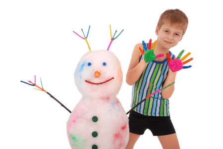Beautiful boy with hands in paint near color snowman with colored horns and hands. On white background.