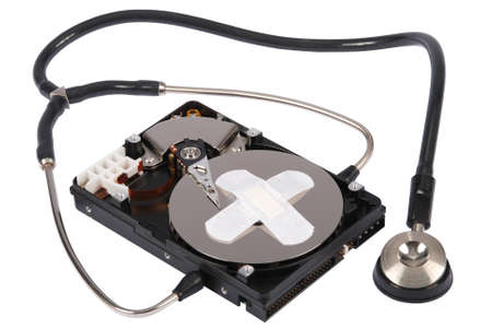 Destroying data from hard disk - conceptual photo. Hard drives and Stethoscope. On white background Stock Photo