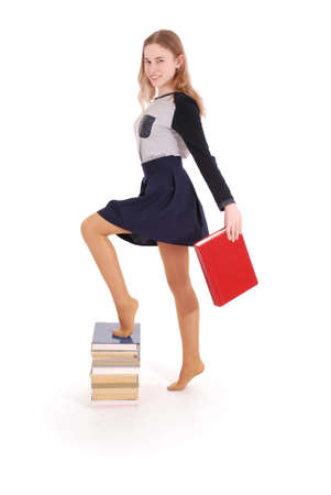 Education, people, teenager and school concept - teenager school girl standing on stack of books. Isolated over white