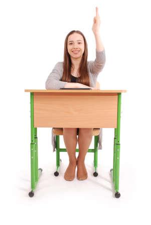 Colegiala adolescente levantando la mano para hacer preguntas aisladas en blanco Foto de archivo - 91437430