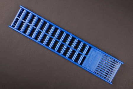 One blue hair extender stops isolated on black background