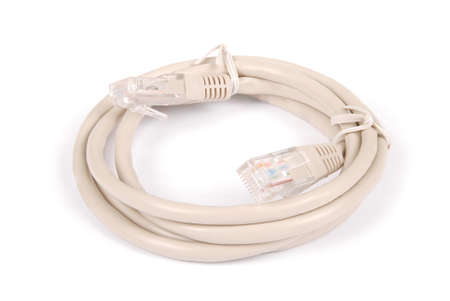 Patch cord grey network cable with molded plug, isolated on a white background 스톡 콘텐츠