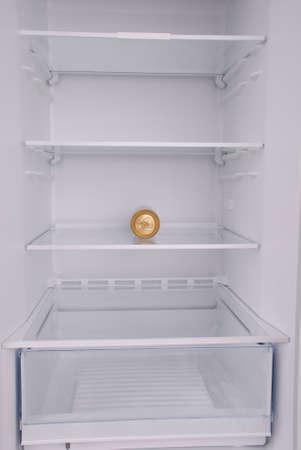 One metal beer cans inside in empty clean refrigerator with opened door